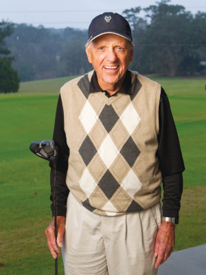 It may be a rainy day, but it's still a golf day for nonagenarian Dr. Bert Fletcher.